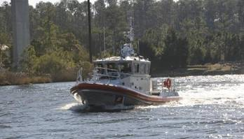 File 45-foot Response Boat - Medium is shown transiting the Pamlico River toward Coast Guard Station Hobucken, N.C., Thursday, Dec. 12, 2013, where it was delivered to replace their 41-foot Utility Boat. The boat is the service