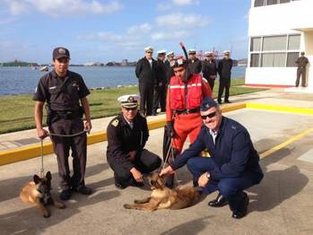 File Rear Adm. Karl Schultz, commander of the 11th Coast Guard District, visits the Mexican Navy Second Naval Region's K-9 unit where handlers demonstrated how the dogs carry out contraband detection Thursday, Dec. 5, 2013, in Ensenada, Mexico. The trip was in part of a joint two-day search and rescue exercise with members of the Mexican Navy. U.S. Coast Guard photo.