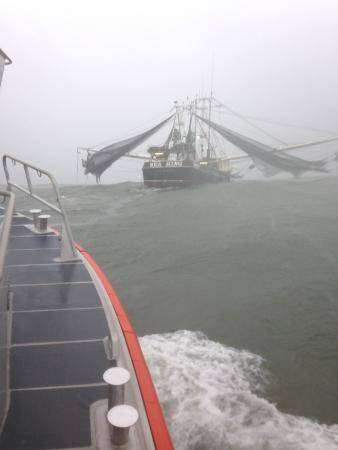 File A Coast Guard boat crew aboard a 45-foot Response Boat - Medium from Station Mayport in Atlantic Beach, Fla., escorts the shrimp boat Sea King as it makes it