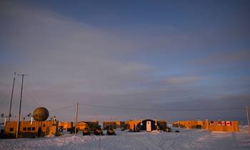 File The view at sunset of Ice Camp Nautilus, located on a sheet of ice adrift on the Arctic Ocean, during Ice Exercise (ICEX) 2014. ICEX 2014 is a U.S. Navy exercise highlighting submarine capabilities in an arctic environment. (U.S. Navy photo by Joshua Davies)