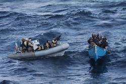 File A visit, board, search and seizure team from the guided-missile destroyer USS Pinckney (DDG 91) approaches a suspected pirate vessel after the Motor Vessel Nordic Apollo reported being under attack and fired upon by pirates. (U.S. Navy photo/Released)