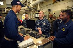 File Chief of Naval Operations (CNO) Adm. Jonathan Greenert talks with Sailors aboard the amphibious assault ship USS Wasp (LHD 1) during exercise Bold Alligator 2012. Bold Alligator is the largest naval amphibious exercise in the past 10 years and represents the Navy and Marine Corps