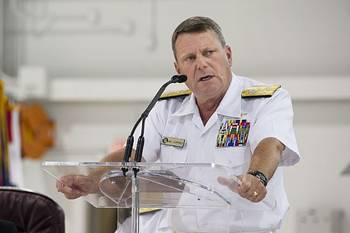 File Commander of U.S. Fleet Forces Command Adm. Bill Gortney delivers remarks during the rollout ceremony for the U.S. Navy