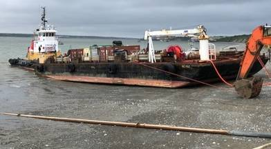 The Coast Guard responds to a fuel barge that sett