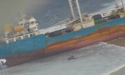 The 308-foot Chinese-flagged commercial fishing carrier Ou Ya Leng No. 6 is aground off the Marshall Islands (CREDIT: USCG)