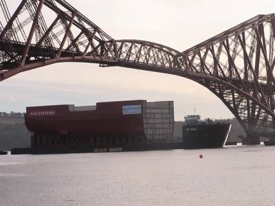 11,300t section of HMS Queen Elizabeth passing under the Forth Bridge as it nears the end of the journey to Fife