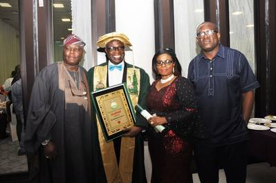 L-R: Assistant Director, Maritime Safety, Nigerian Maritime Administration and Safety Agency (NIMASA) Engineer Olu Aladenusi, FNSE, Executive Director, Operations, NIMASA, Engr. Rotimi Fashakin, FNSE, His Wife Mrs. Olubisola Fashakin and Head, Corporate Communications, NIMASA, Mr. Isichei Osamgbi at the conferment of the Fellowship status to the NIMASA ED, Operations by the Nigerian Society of Engineers in Abuja recently.  (Photo courtesy of NIMASA)