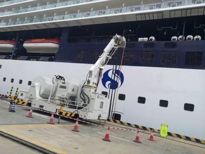 A battery-powered AMPMobile unit connects a ship to shore power at Shenzhen cruise terminal. (Photo:Cavotec)