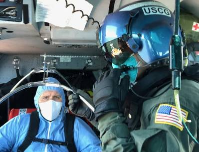 A Coast Guard Air Station Houston MH-65 Dolphin helicopter aircrew medevacs a 36-year-old crewmember from a tanker vessel approximately 35 miles offshore Freeport, Texas, July 30, 2020. The crewmember was transferred to awaiting emergency services personnel and was reported to be in stable condition. (U.S. Coast Guard photo)