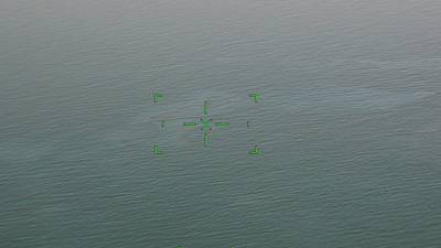 A Coast Guard Aviation Training Center Mobile HC-144 Ocean Sentry airplane crew conducts an overflight assessment Sept. 5, 2021 of the Bay Marchand approximately 2 miles south of Port Fourchon, Louisiana. The crew witnessed an 11-mile rainbow sheen that the Coast Guard is actively monitoring. (U.S. Coast Guard photo by Coast Guard Aviation Training Center Mobile)