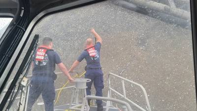 A Coast Guard boat crew attempts to throw a hammer at the hull of the Seacor Power in an attempt to make contact with potential survivors inside the vessel. (U.S. Coast Guard photo courtesy of Coast Guard Station Grand Isle)