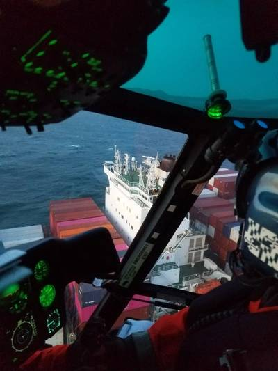 A Coast Guard helicopter crew approaches the Yang Ming Unanimity containership to conduct a medevac near the San Francisco Bay in San Francisco, Calif., April 4, 2020. (U.S. Coast Guard courtesy photo)