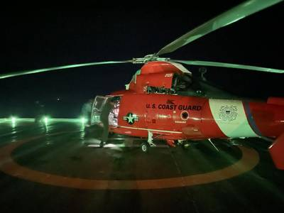 A Coast Guard helicopter crew prepares to medevac an oil rig crew member experiencing a cardiac event on the Hoover-Diana oil platform, 150 miles east of Corpus Christi, Texas, August 19, 2021. (U.S. Coast Guard photo, courtesy Air Station Houston)