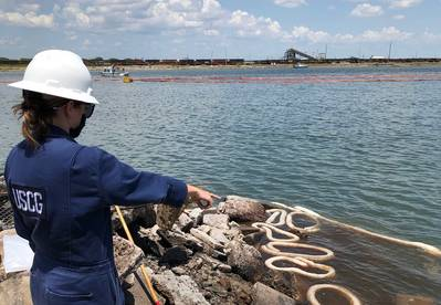 A Coast Guard pollution responder observes the Port of Corpus Christi Ship Channel for possible pollution impacts after the dredging vessel Waymon L Boyd sank in Corpus Chrisiti, Texas. (U.S. Coast Guard photo)