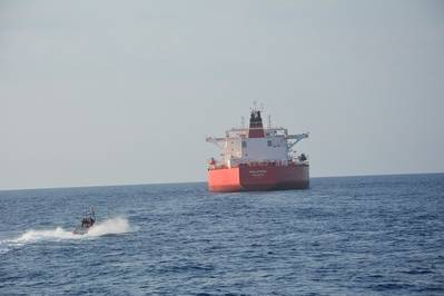 A Coast Guard small boat crew approaches the 820-foot motor tanker, Philotimos, approximately 155 miles southwest of Key West, Thursday. (U.S. Coast Guard Photo)