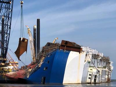 A crane positions the 16th and final lifting lug onto the Golden Ray hull in St. Simons Sound, Ga. (Photo: St. Simons Sound Incident Response)