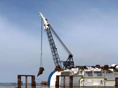 A crane transfers the final lifting lug to be welded to the hull of the Golden Ray in St. Simons Sound, Georgia, June 3, 2020. The 16 lifting lugs will provide connection points for the 255-foot tall Versabar VB 10,0000 crane to fasten to in order to secure sections of the hull as they are cut from the wreck during the Golden Ray's removal. (Photo: St. Simons Sound Incident Response)