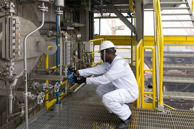 A DNV GL HazMat Expert doing a visual check for pipe gasket sampling. Photo DNV GL