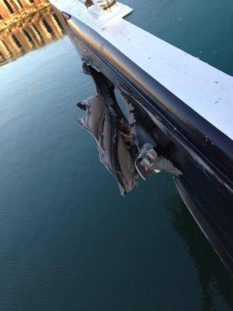 A gash in the hull of a barge is the result of a collision between the tugboats Yellowfin and Capt. Warren that occurred in the Corpus Christi ship channel, Dec. 17, 2013. Coast Guard Sector Corpus Christi has dispatched marine investigators to determine the cause of the collision. (U.S. Coast Guard photo)