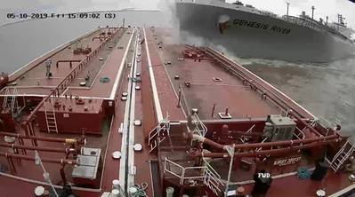 A screen capture from wheelhouse video on board the towing vessel Voyager shows the moment when the LPG tanker Genesis River struck barge 30015T, March 10, 2019. (Source: Kirby Inland Marine / NTSB)