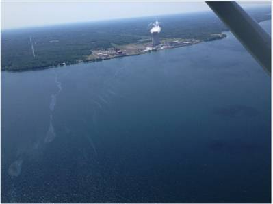 A sheen is visible from the air in Lake Ontario near the Fitzpatrick Nuclear Power Plant in Scriba, New York, approximately 10 miles northeast of Oswego, New York, June 26, 2016. A Coast Guard Auxiliary air crew noticed the sheen during a flight and reported it to Coast Guard Sector Buffalo. (U.S. Coast Guard photo)