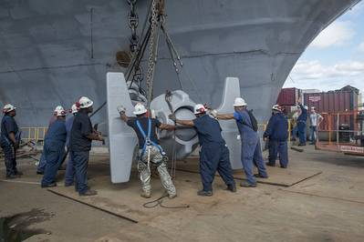 A team of shipbuilders replaces USS Abraham Lincoln's anchor with one removed from USS Enterprise. Lincoln is undergoing a refueling and complex overhaul at Newport News Shipbuilding at the same time Enterprise is being inactivated. Photo by Ricky Thompson/HII