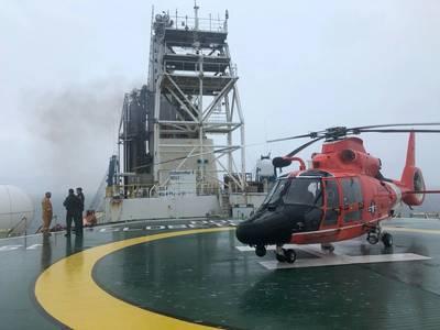 A U.S. Coast Guard Air Station New Orleans aircrew aboard the Noble Globetrotter II. (Photo: U.S. Coast Guard)