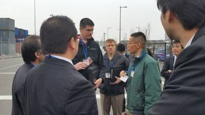 A U.S. Coast Guard International Port Security team meets with Japanese officials. The engagement involved sharing best practices and visiting with the Ministry of Land, Infrastructure, Transport and Tourism's Ports and Harbors Bureau to observe the implementation of the International Ship and Port Facility Security Code at two port facilities in Hakata, Japan: the Hakata Chuo passenger wharf and the Hakata island city area container terminal. (U.S. Coast Guard photo by Activities Far East)