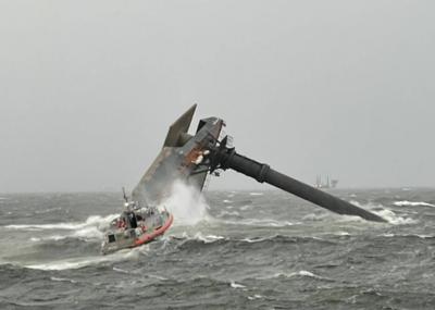 A U.S. Coast Guard Response Boat-Medium boat crew heads toward the capsized lift boat Seacor Power about 8 miles off Port Fourchon, La. on April 13, 2021. (U.S. Coast Guard photo courtesy of Coast Guard Cutter Glenn Harris)