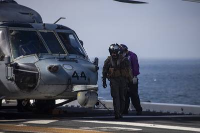 A U.S. Navy MH-60 Seahawk pilot returns to the amphibious assault ship USS Makin Island during search and rescue operations following an AAV-P7/A1 assault amphibious vehicle mishap off the coast of Southern California, July 30, 2020.  U.S. Marine Corps photo by Cpl. Patrick Crosley