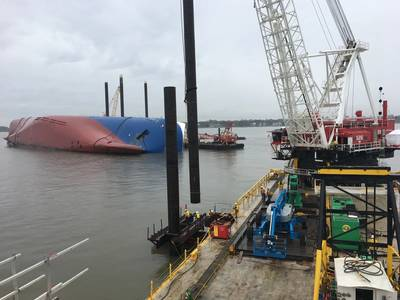 A Weeks Marine crane prepares to drive a pile using a vibratory hammer on February 26, 2020, near St. Simons Island, Ga., as part of the construction of the environmental protection barrier (EPB) around the motor vessel Golden Ray. (Photo by Tyler Drapeau)