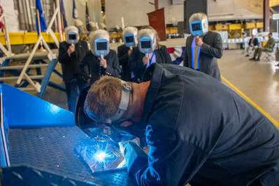 A welder authenticates the keel of Littoral Combat Ship (LCS) 31, the future USS Cleveland, by welding the initials of the ship's sponsor, Robyn Modly, wife of a Clevelander and former U.S. Navy Secretary, who has embraced the city as her own. (Photo: Lockheed Martin)