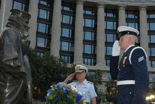 Adm. Robert J. Papp Jr., the Coast Guard Commandant, and Seaman John Kroll, a member of the Ceremonial Honor Guard, salute the statue of the ÒLone SailorÓ during the Coast Guard Dixieland Band Concert at the Navy Memorial Plaza, Aug. 3, 2010. The concert was held to honor the 220th birthday of the Coast Guard. U.S. Coast Guard photo by Petty Officer 1st Class Kip Wadlow.