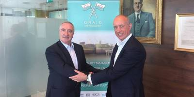 Alasdair Evitt, Group Director, Ship Management East, V.Group shakes hands with Hugh Williams, Chief Executive Officer, Graig Shipping Plc following announcement to employees in Cardiff and Shanghai (Photo: V.Group)