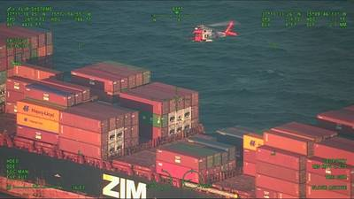 An Air Station MH-60 Jayhawk helicopter hovers over a containership 48 miles east of Virginia Beach, Va. A medevac was requested by the captain of the Zem Shekou after a crew member was found passed out on deck. (U.S. Coast Guard photo)