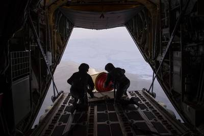 An Air-Deployable Expendable Ice Buoy is deployed in the high Arctic near the North Pole from a Royal Danish Air Force C-130 aircraft operating out of Thule Air Force Base in Greenland, as part of the International Arctic Buoy Program (IABP). Photo: United States Navy