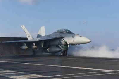 "An F/A-18F Super Hornet assigned to the ""Black Lions"" of Strike Fighter Squadron (VFA) 213 launches from the aircraft carrier USS George H.W. Bush (CVN 77). Photo: United States Navy"