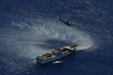 An HH-60G Pave Hawk rescue helicopter from the 129th Rescue Wing hovers over the Chinese fishing vessel Fu Yua (Photo: California Air National Guard).