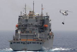 An SA-330J Puma helicopter carries supplies to the amphibious dock landing ship USS Ashland (LSD 48) during a vertical replenishment. Ashland is part of the Nassau Amphibious Ready Group supporting maritime security operations and theater security cooperation operations in the U.S. 5th Fleet area of responsibility. (U.S. Navy photo by Mass Communication Specialist 2nd Class Jason R. Zalasky/Released)