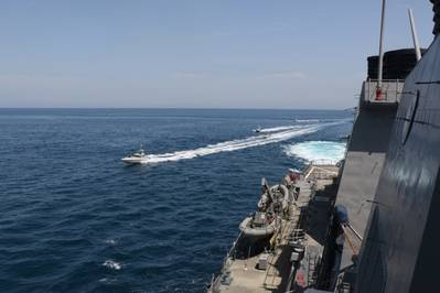 Iranian Islamic Revolutionary Guard Corps Navy (IRGCN) vessels approach U.S. Military ships in international waters of the North Arabian Gulf. (U.S. Navy photo)