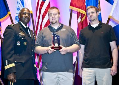 Army Brig. Gen. Darrell K. Williams (left) presents award to Wing representatives Dave Ackroyd and Aaron Powell.