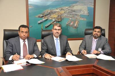 ASRY Chief Executive Nils Kristian Berge (centre) signs deal with Solas Marine Services General Manager Sanjay Prabhu (right)