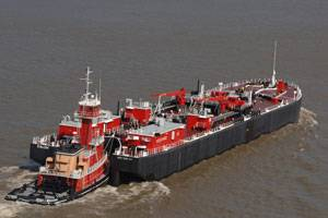 ATB Tug Rhea I. Bouchard and Barge B. No. 284 depart the New Orleans terminal with the barge's first load of cargo following the delivery of the new barge from Bollinger Gretna, LLC.