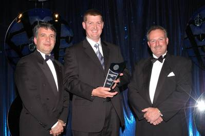Austal's Richard Williams (center) accepts AMTIL's Advanced Manufacturer of the Year award from Major Sponsor Deloitte's Tom Imbesi (left) and AMTIL CEO Shane Infanti.