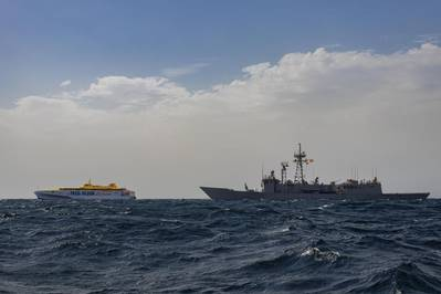 Bajamar Expess trimaran being escorted by the Spanish frigate ESPS Santa Maria