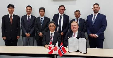 Below seated: KHI Managing Executive Officer, Takeshi Ohata; and Corvus Energy CEO, Geir Bjørkeli.Standing left to right: KHI—Tatsuya Onodera, Technical Manager; Tatsuya Ohno, Technical Manager; Takenori Hino, Senior Manager; Corvus— Per Erik Schumann-Olsen, Executive Advisor; Pradeep Datar, VP Sales – Asia; Sean Puchalski, EVP Strategy & Business Planning. Photo: Corvus Energy