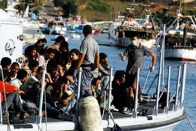 Boat migrants: Photo CCL credit Happolati