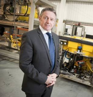 BRIL Managing Director Mike Arnold in front of Remotely Operated Vehicle (ROV)