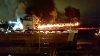 By 8:20 p.m. St. Clair's cargo conveyor boom had become completely engulfed in flames (Photo: Great Lakes Trader chief engineer / NTSB)