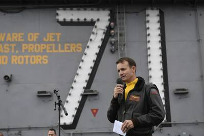 Capt. Brett Crozier addresses crew during an all-hands call on the USS Theodore Roosevelt (CVN 71) flight deck in November 2019. (U.S. Navy photo by Nicholas Huynh)